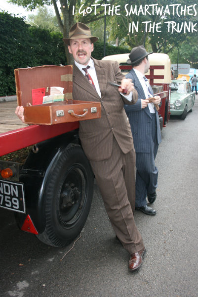 """Man dressed as a spiv"" by Supermac1961 from CHAFFORD HUNDRED, England - Spivs selling goods from the 'back of a lorry'. Licensed under CC BY 2.0 via Wikimedia Commons."